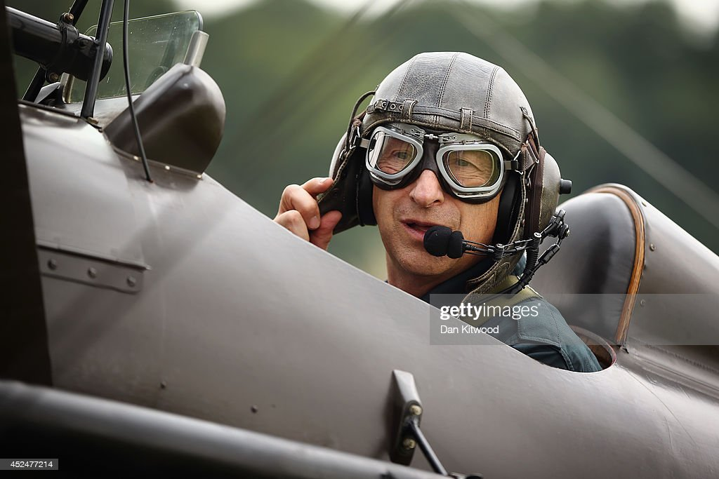 Shuttleworth Collection Pilot Rodger 'Dodge' Bailey prepares for a demonstration flight in a SE5a at 'The Shuttlesworth Collection' at Old Warden on July 21, 2014 in Biggleswade, England. Of the 55,000 planes that were manufactured by the Royal Army Corps (RAC) during WWI, only around 20 remain in airworthy condition. Six of these belong to The Shuttleworth Collection at Old Warden, Bedfordshire, making it the most complete collection of original airworthy WWI aircraft in the world. Amongst the collection is the SE5a. The SE5a is a single seater fighter aircraft. It is an original biplane designed by the Royal Aircraft Factory, with its engine built by Wolseley Motors Ltd, and it was issued to 84 Squadron in November 1918. The National Archive in Kew has recently verified that the plane saw action in France with 84 Squadron the day before Armistice, November 10, 1918.
