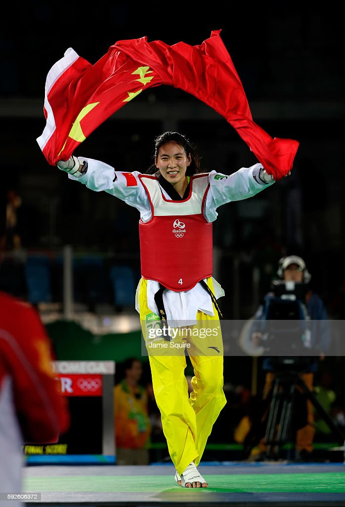 Shuyin Zheng of China celebrates beating Maria del Rosario Espinoza Espinoza of Mexico during the Taekwondo Women 67kg Gold Medal Contest on Day 15...
