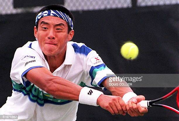 Shuzo Matsuoka of Japan dives for a shot from David Rikl of Czechoslovakia during their Mens first round play of The Lipton Championships in Key...