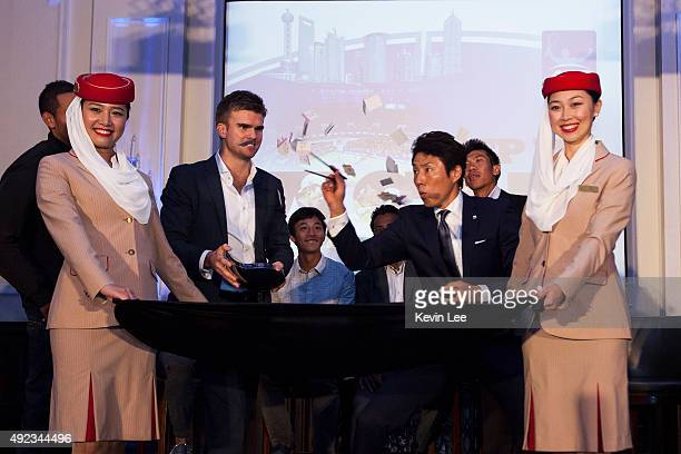 Shuzo Matsuoka uses chopsticks to pick a winner's ticket at an ATP event on October 12 2015 in Shanghai China