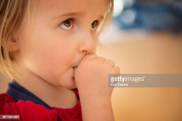 Shy child (4-5) sucking thumb for reassurance