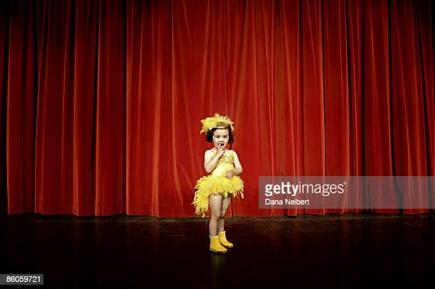 Shy girl in costume on stage