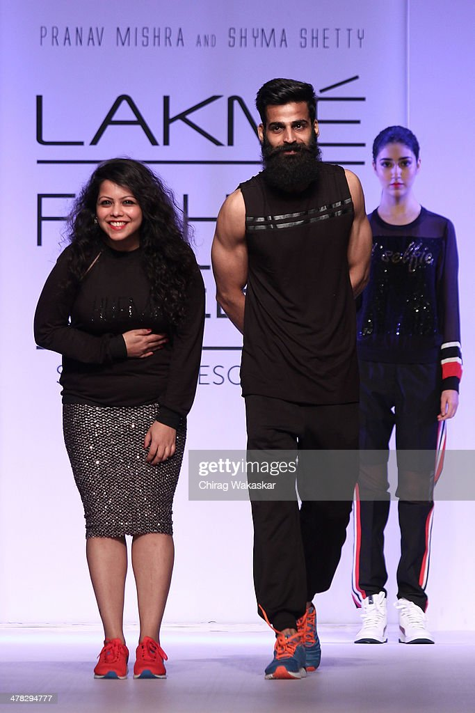 Shyma Shetty (L) & Pranav Mishra (R) walk the runway at day 2 of Lakme Fashion Week Summer/Resort 2014 at the Grand Hyatt on March 12, 2014 in Mumbai, India.