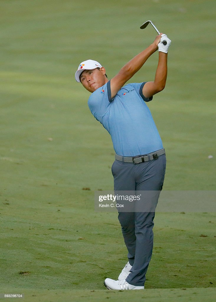 Si Woo Kim hits a shot on the 18th hole on his way to winning the Wyndham Championship during the final round at Sedgefield Country Club on August 21, 2016 in Greensboro, North Carolina.