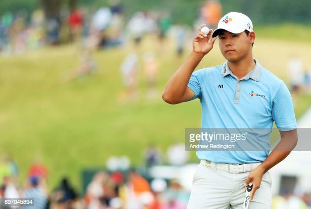 Si Woo Kim of Korea reacts after finishing on the 18th green during the third round of the 2017 US Open at Erin Hills on June 17 2017 in Hartford...