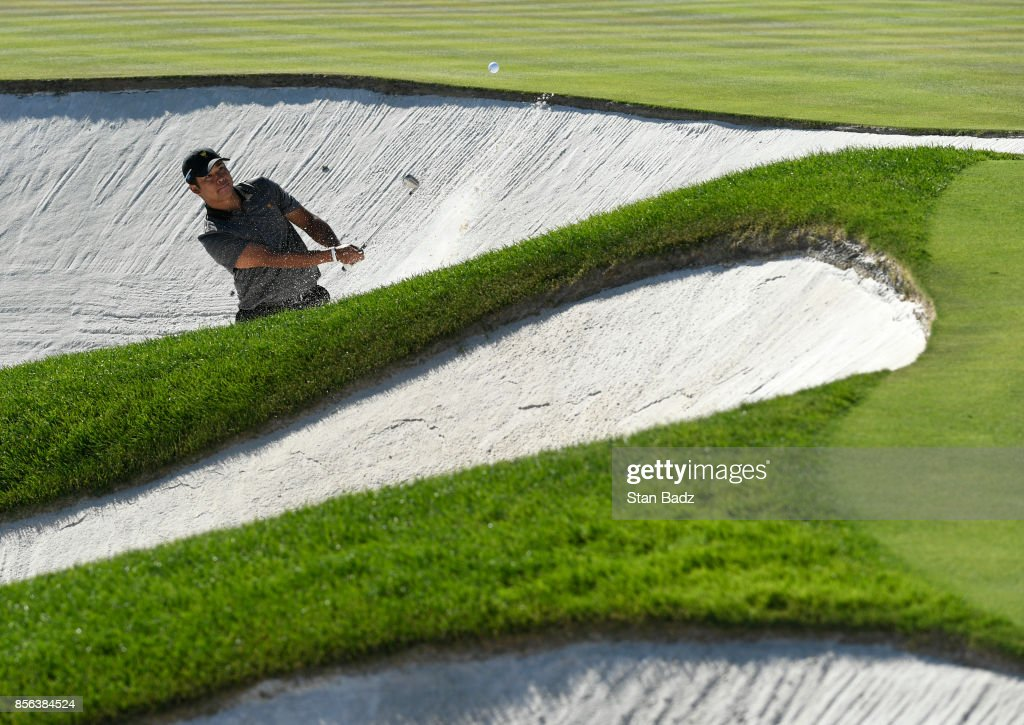 Si Woo Kim of South Korea and the International Team plays his shot out of the bunker during the Sunday singles matches at the Presidents Cup at Liberty National Golf Club on October 1, 2017, in Jersey City, New Jersey.