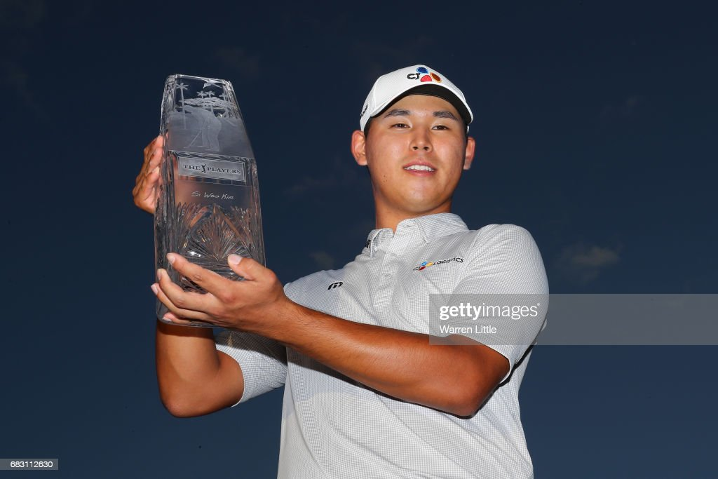 Si Woo Kim of South Korea celebrates with the winner's trophy after the final round of THE PLAYERS Championship at the Stadium course at TPC Sawgrass on May 14, 2017 in Ponte Vedra Beach, Florida.
