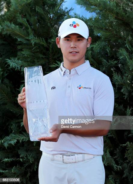 Si Woo Kim of South Korea holds the trophy after his win in the final round of the THE PLAYERS Championship on the Stadium Course at TPC Sawgrass on...