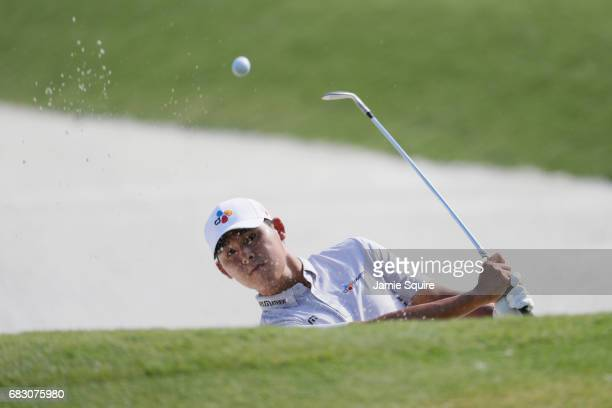 Si Woo Kim of South Korea plays a shot from a bunker on the tenth hole during the final round of THE PLAYERS Championship at the Stadium course at...