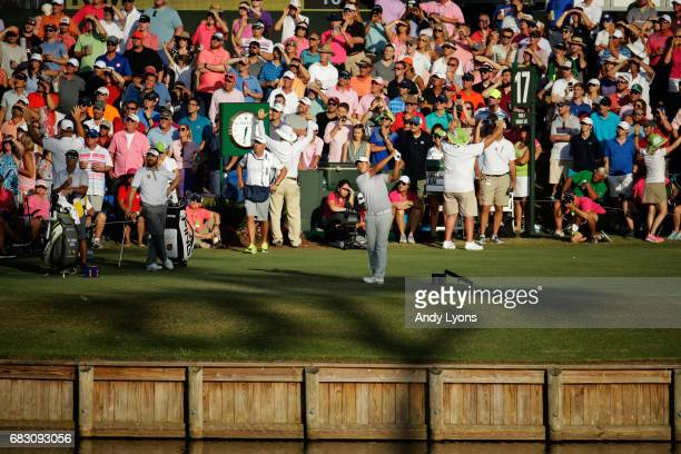 Si Woo Kim of South Korea plays his shot from the 17th tee during the final round of THE PLAYERS Championship at the Stadium course at TPC Sawgrass...