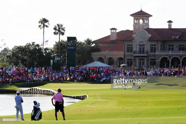 Si Woo Kim of South Korea prepares to play his second shot on the 18th hole during the final round of THE PLAYERS Championship at the Stadium course...