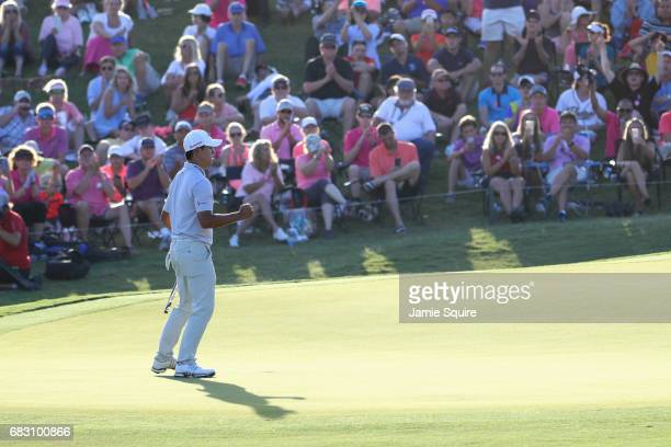 Si Woo Kim of South Korea putts on the 18th green to win the final round of THE PLAYERS Championship at the Stadium course at TPC Sawgrass on May 14...