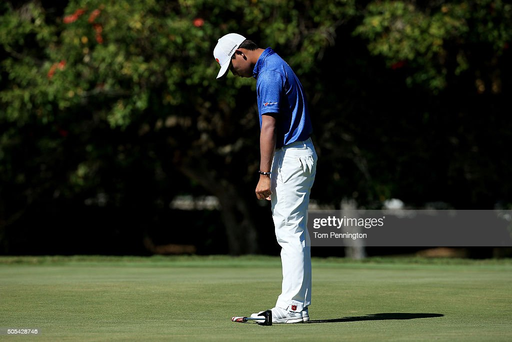 Si Woo Kim of South Korea reacts to a missed putt on the seventh green during the final round of the Sony Open In Hawaii at Waialae Country Club on...