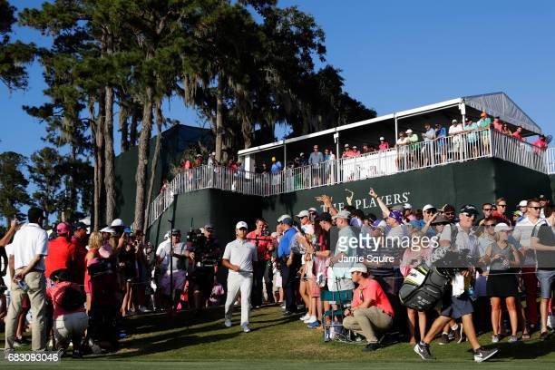 Si Woo Kim of South Korea walks to the 18th tee during the final round of THE PLAYERS Championship at the Stadium course at TPC Sawgrass on May 14...