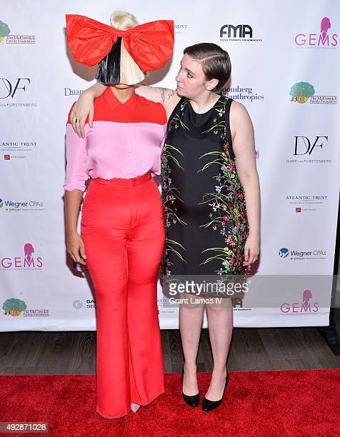 Sia and Lena Dunham attend the GEMS' 2015 Love Revolution Gala at Pier 59 on October 15 2015 in New York City