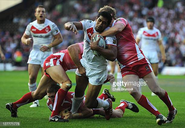Sia Soliola of St Helens is tackled by Brett Finch of Wigan Warriors during the Engage Super League Play Off match between St Helens and Wigan...