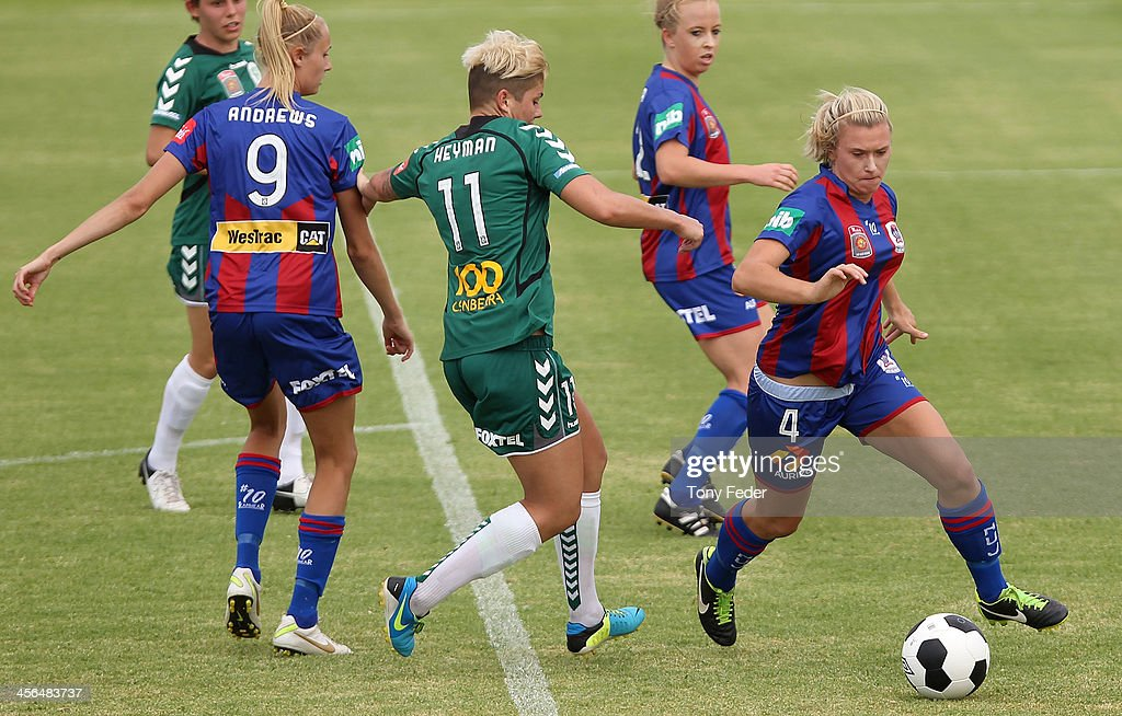 Siahn Bozanic of the Jets controls the ball ahead of Canberra United defence during the round five W-League match between the Newcastle Jets and Canberra United at Wanderers Oval on December 14, 2013 in Newcastle, Australia.