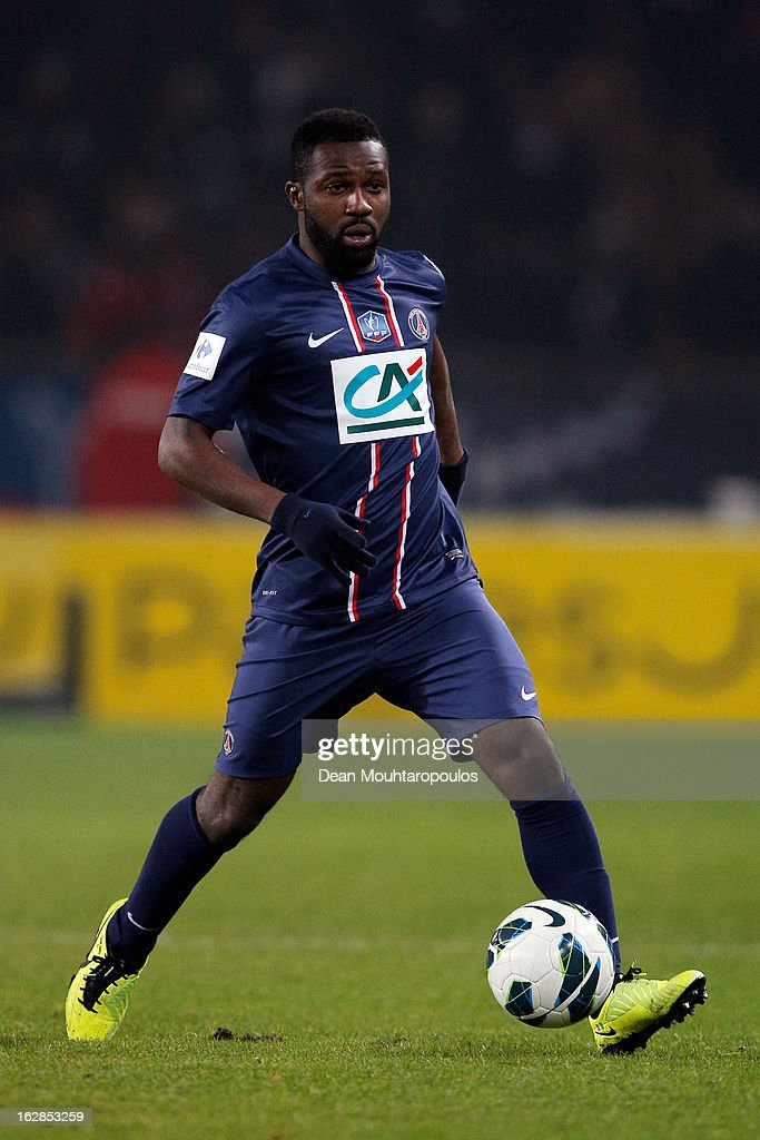 <a gi-track='captionPersonalityLinkClicked' href=/galleries/search?phrase=Siaka+Tiene&family=editorial&specificpeople=788647 ng-click='$event.stopPropagation()'>Siaka Tiene</a> of PSG in action during the French Cup match between Paris Saint-Germain FC and Marseille Olympic OM at Parc des Princes on February 27, 2013 in Paris, France.