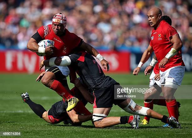 Siale Piutau of Tonga is tackled by Viktor Kolelishvili of Georgia during the 2015 Rugby World Cup Pool C match between Tonga and Georgia at...