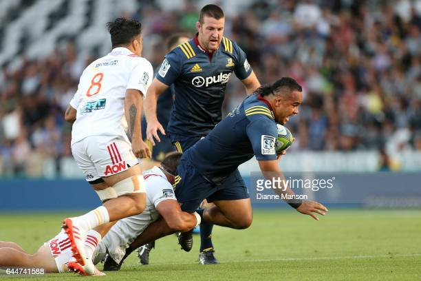 Siate Tokolahi of the Highlanders tries to break the tackle of Kane Hames of the Chiefs during the round one Super Rugby match between the...
