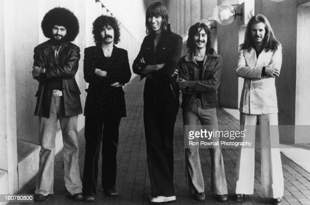 Sib Hashian Brad Delp Tom Scholz Fran Sheehan and Barry Goudreau of the rock group 'Boston' pose for a portrait holding their guitars in circa 1976
