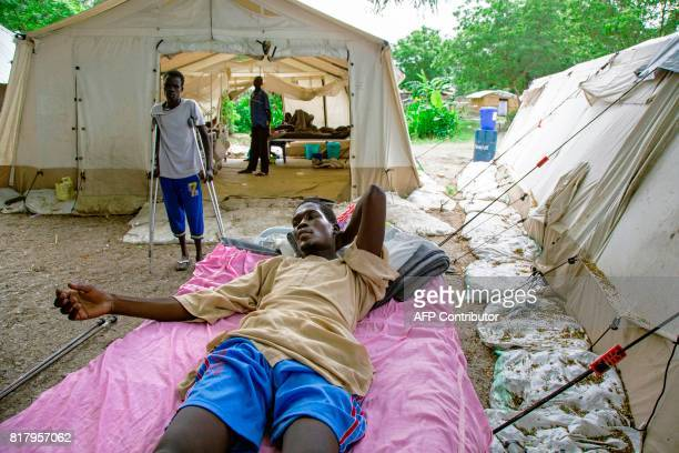 Sibit Peter a civilian who suffered a gunshot wound to his stomach in Kodok South Sudan lays on a stretcher in Old Fangak South Sudan on July 18 2017...