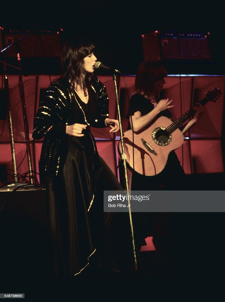 Sibling American musicians Ann and Nancy Wilson of the rock group Heart perform onstage at the Universal Amphitheatre Los Angeles California July 15...