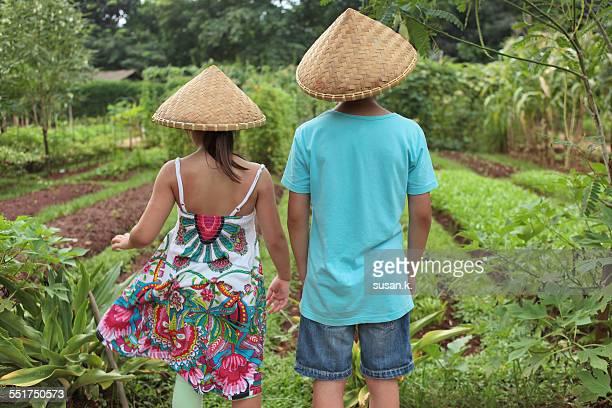 Siblings admiring the growing vegetables