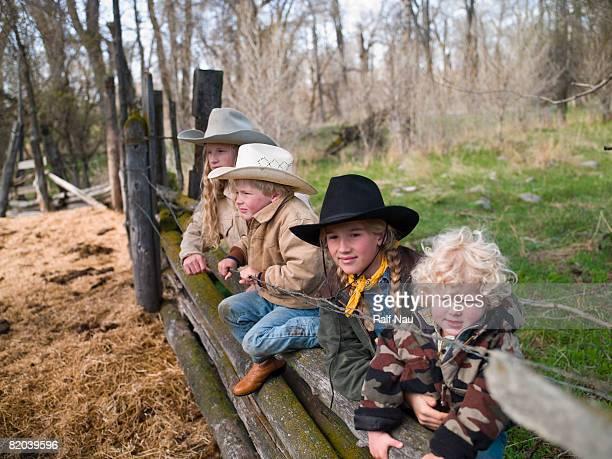 Siblings at cow pasture