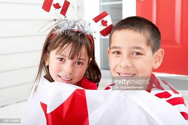 Siblings celebrating Canada Day