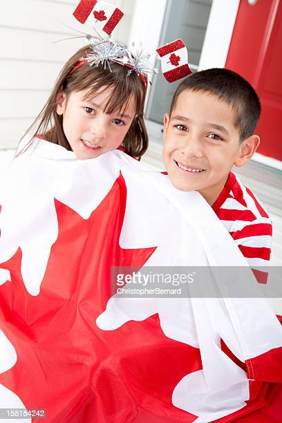 Siblings celebrating Canada Day