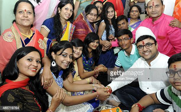 Siblings celebrating on the occasion of Indian festival Raksha Bandhan on August 29 2015 in Indore India On Raksha Bandhan sisters tie a rakhi on her...