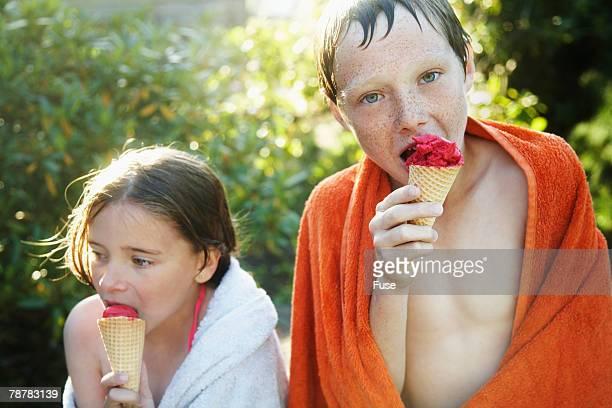 Siblings Enjoying Ice Cream Cones