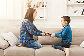 Siblings fighting over remote control at home, brother and sister have quarrel, copy space