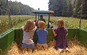 Siblings go for a hay ride