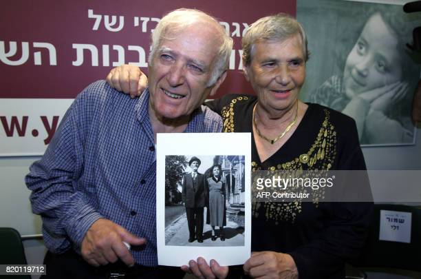 Siblings Hilda Shlick of Ashdod in southern Israel and Simon Glasberg of Ottawa Canada show a photo of their parents at Yad Vashem Holocaust Museum...