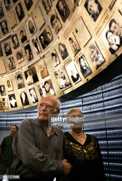 Siblings Hilda Shlick of Ashdod in southern Israel and Simon Glasberg of Ottawa hold hands in the 'Hall of Names' at Yad Vashem Holocaust Museum...