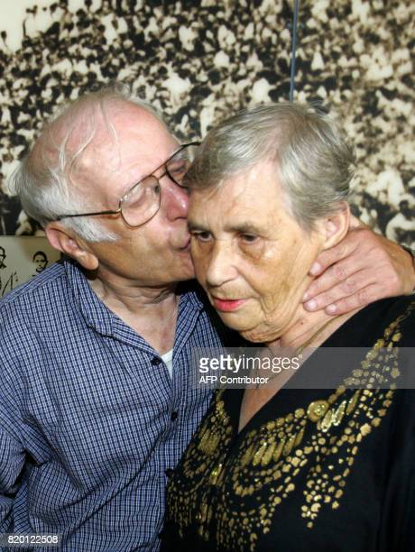 Siblings Hilda Shlick of Ashdod in southern Israel is kissed on the cheek by Simon Glasberg of Ottawa Canada at Yad Vashem Holocaust Museum complex...