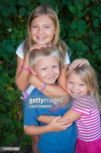 Portrait Of A Brother And Sister Hugging Each Other Stock