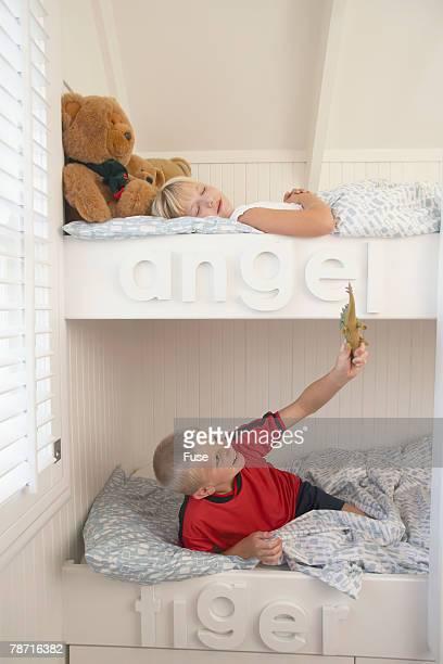 Siblings in Their Bunk Beds