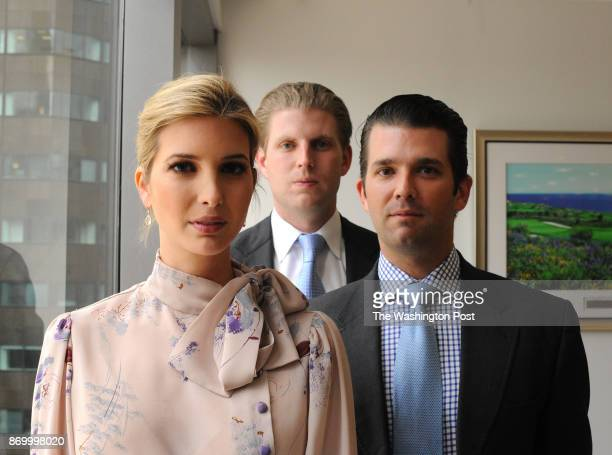 Siblings Ivanka Eric with blond hair in white shirt and blue tie and Donald Trump Jr are seen together in Trump Tower in Manhattan NY 6/6/2012