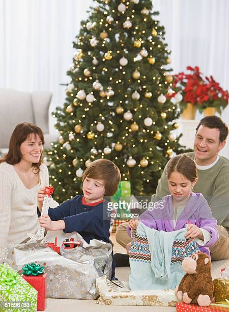 Siblings opening Christmas gifts