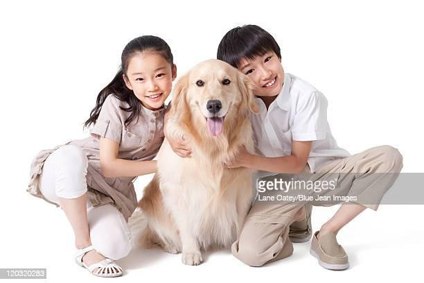 Siblings Petting a Dog