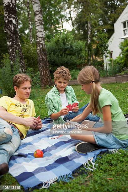 Siblings playing cards