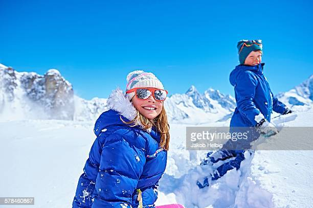Siblings playing in snow, Chamonix, France