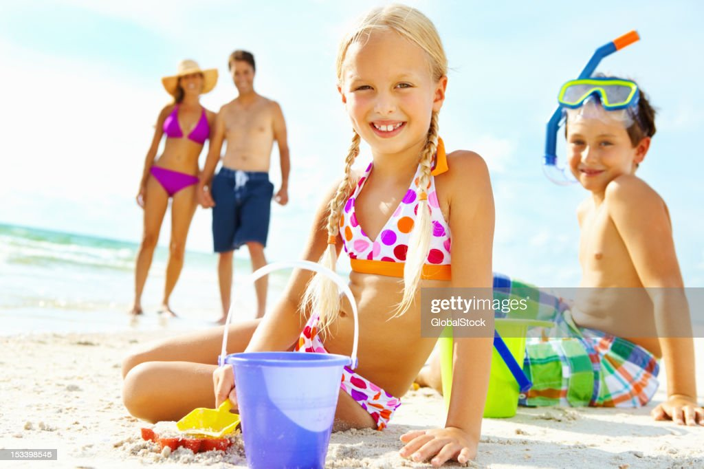 Siblings playing in the sand : Stock Photo