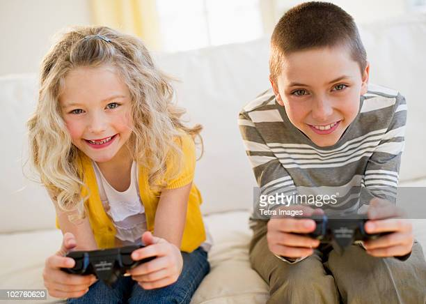 Siblings playing video game