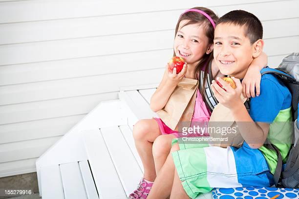 Siblings ready for school