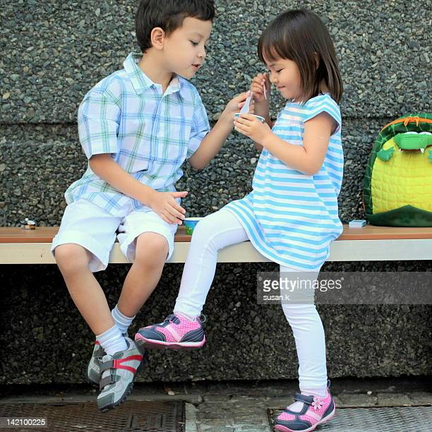 Siblings sharing ice cream