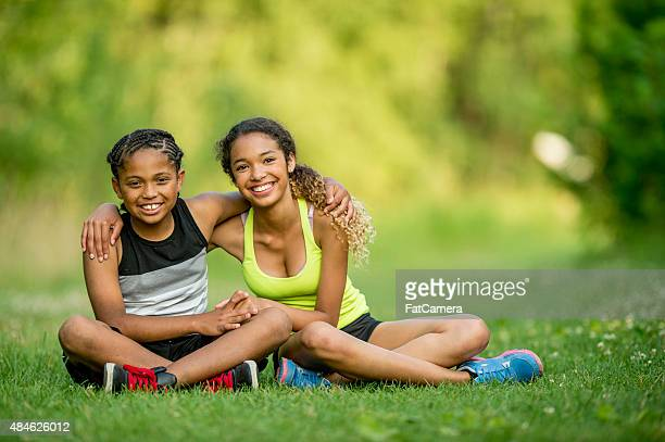 Siblings Sitting at the Park